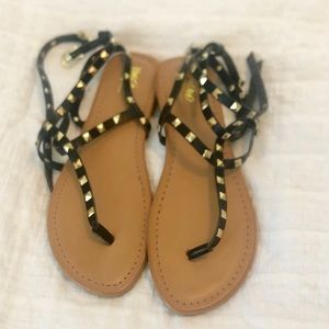 BLACK AND GOLD STUDDED SANDALS